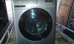 Whirlpool 9kg silver front load washing machine.