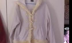 White jacket with fur trimmings. Size 34. Good