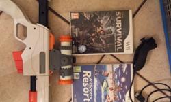 Wii console,plus 2 remotes,one with motion sensor and