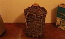 Old wine canister with woven bamboo. Not broken and can