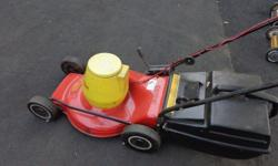 wolf  electric mower in good condition new blade with