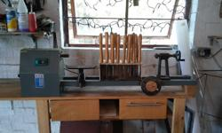 Wood lathe and tools as per photo. 1000mm between