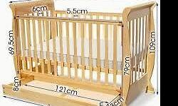 Wooden Baby Cot in very good condition. Solid Pine with