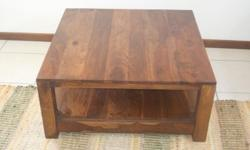 Lovely and basically new square wooden coffee table