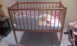 A practically new wooden cot. This offer includes the