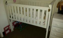 Wooden Cot painted white. Excellent condition
