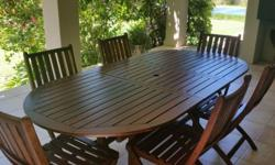 Excellent condition wooden patio 6 seater dining set.