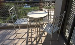 Beautiful Wrought iron table and chairs. R2500 for the