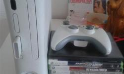 xbox for sale with 8 games and remote with cables. good