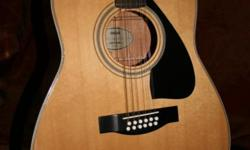 Beskrywing Acoustic guitar in perfect condition,