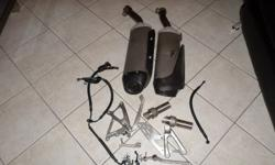 I am selling Yamaha R1 factory exhaust pipes, foot pegs