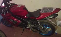 For sale is my R1 2005. It has titanium headers and